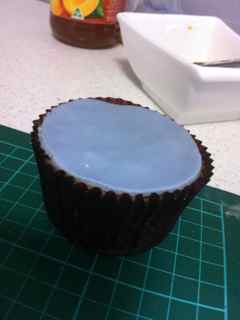 Start Making The Mouth By Rolling Out An Oval Shape Of Grey Fondant